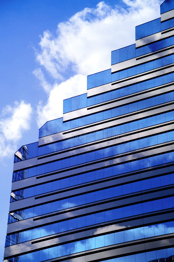 Corporate Clouds. Modern Corporate building with blue sky and clouds stock photography