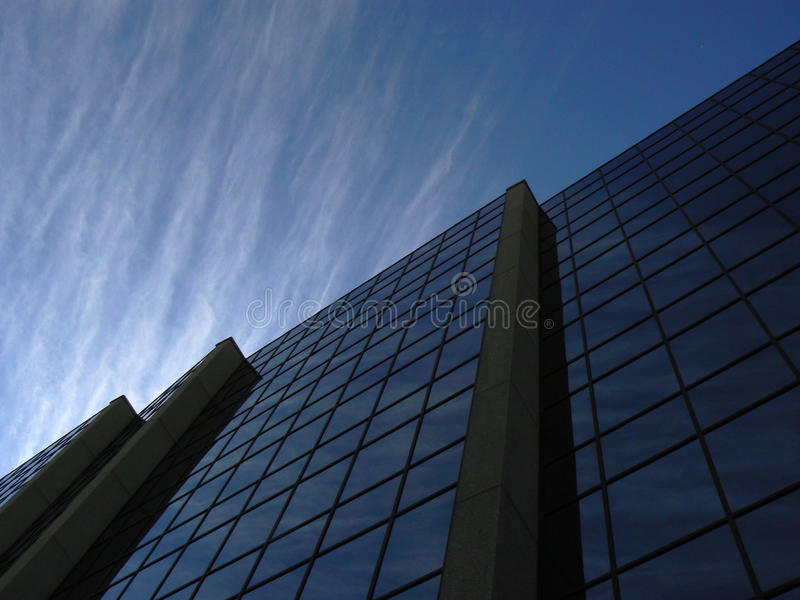 Corporate Cloudscape reflected in Commercial office building in Winnipeg Canada. CAN royalty free stock photos