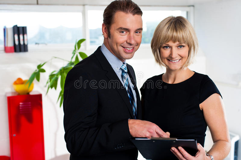 Corporate couple reviewing weekly schedule