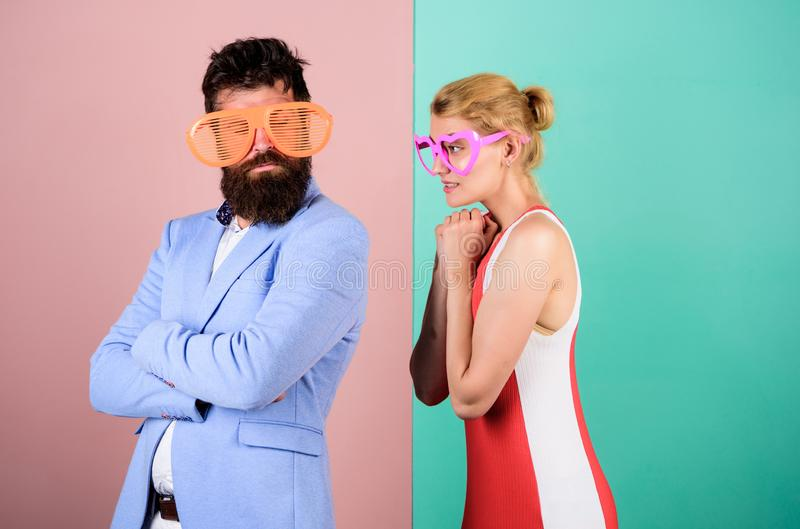 Corporate culture. bearded man with pretty woman. party fun. couple in love. hipster guy and girl party glasses. Office royalty free stock photos