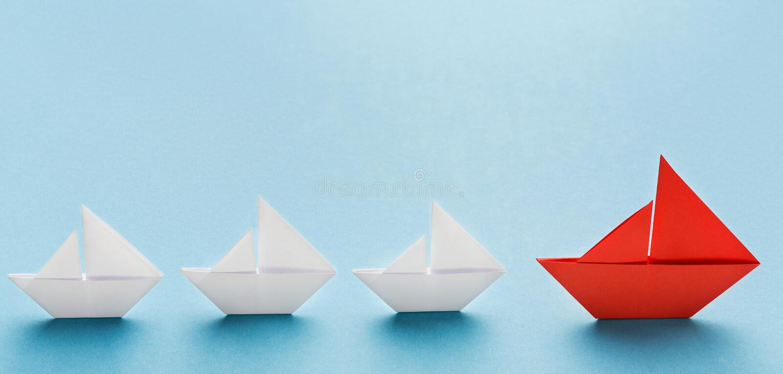 Corporate culture and discipline illustrated by office subjects in strict order. Corporate culture and discipline at work. Small white boats following big red stock photography