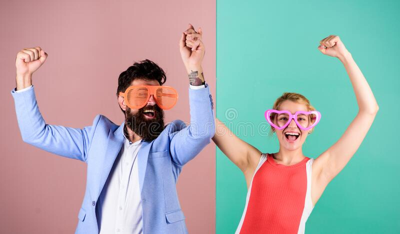 Corporate culture. Diving into celebration. Playful businessman and colleague celebrating. Celebrating holiday. Bearded. Men pretty women party goggles stock photo
