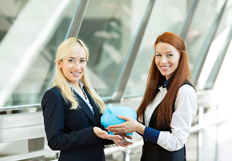 Corporate employee giving piggy bank to happy customer stock image