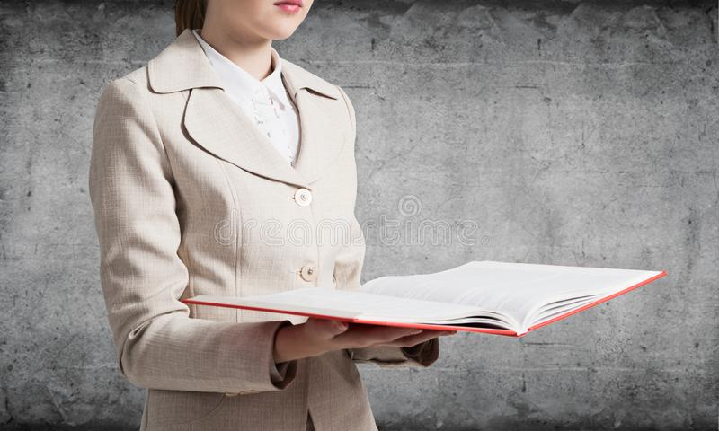 Corporate employee holding open notebook royalty free stock images