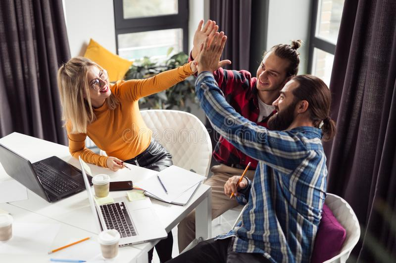 Corporate employee success, hands together. Business team royalty free stock image