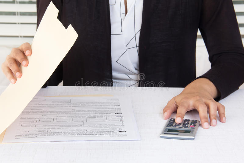 Corporate employee working on financial data at workplace stock photo
