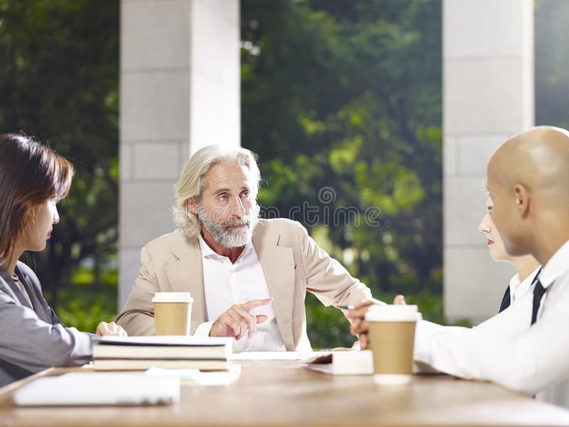 Corporate executives meeting discussing business in modern build stock photos