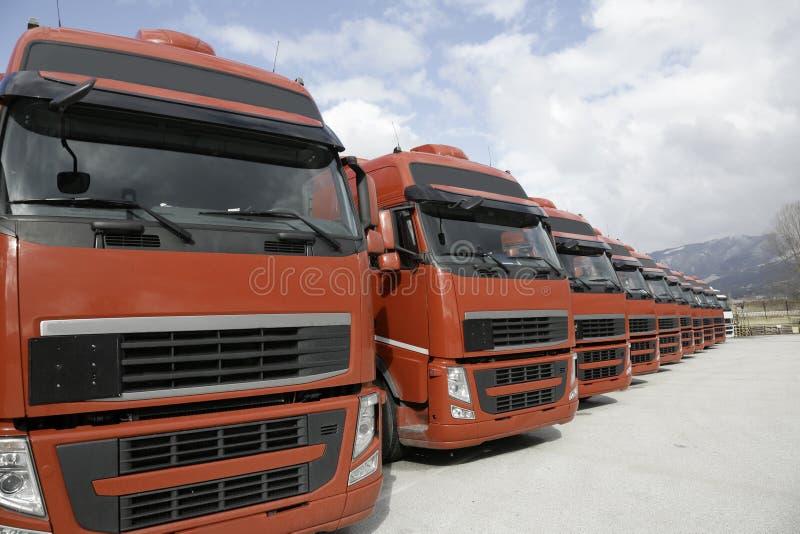 Corporate fleet trucks lined. Transportation company stock photography