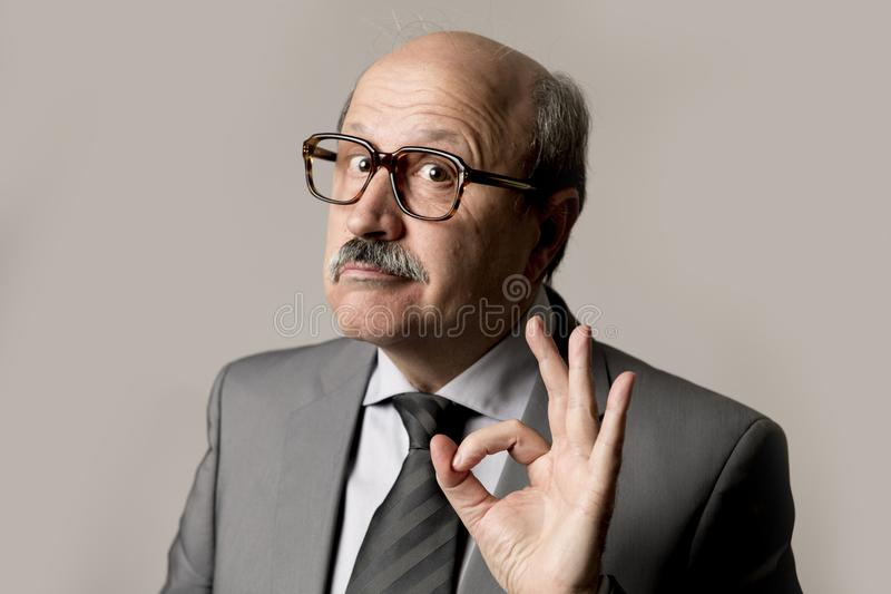 corporate full body portrait bald 60s happy and confident business posing neat and tidy smiling isolated on grey royalty free stock image
