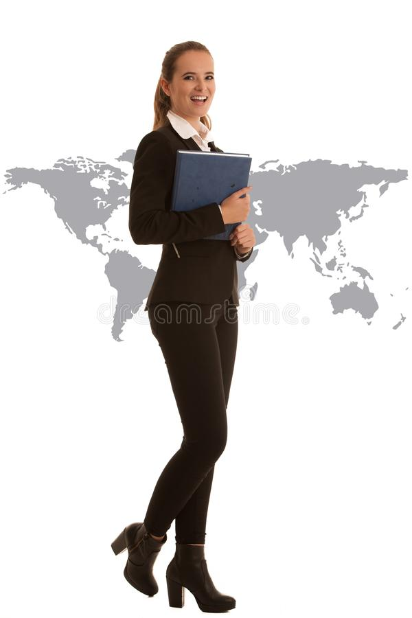 Corporate full length portrait of a preety business woman with b. Lue folder isolated over white background with world map as a sign of globalisation stock photography