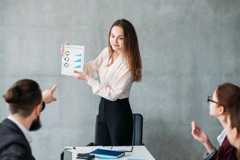 Corporate growth statistics analyst report discuss. Corporate growth rates statistics. Financial analyst report. Business team members discussing diagrams in royalty free stock images