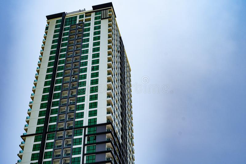 Corporate high-rise building seen in the blue sky and clouds. Corporate high-rise building seen in the blue sky and clouds stock photos