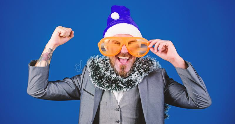 Corporate holiday party ideas employees will love. Corporate christmas party. Man bearded hipster wear santa hat and royalty free stock photography