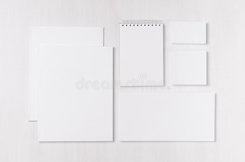 Corporate identity template with black white paper stationery set on soft white elegance wood board. stock photos