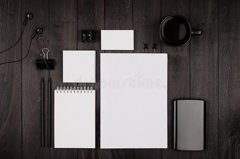 Corporate identity template, blank stationery set with coffee and earphone on black stylish wood background. Mock up for branding, business presentations and royalty free stock photos