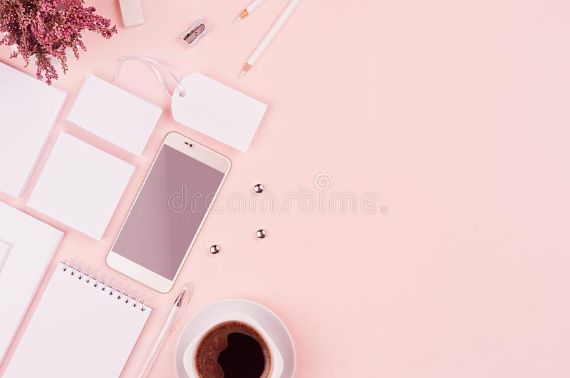 Corporate identity template with white stationery set, heather flowers, coffee, phone on soft pastel pink background. royalty free stock photo
