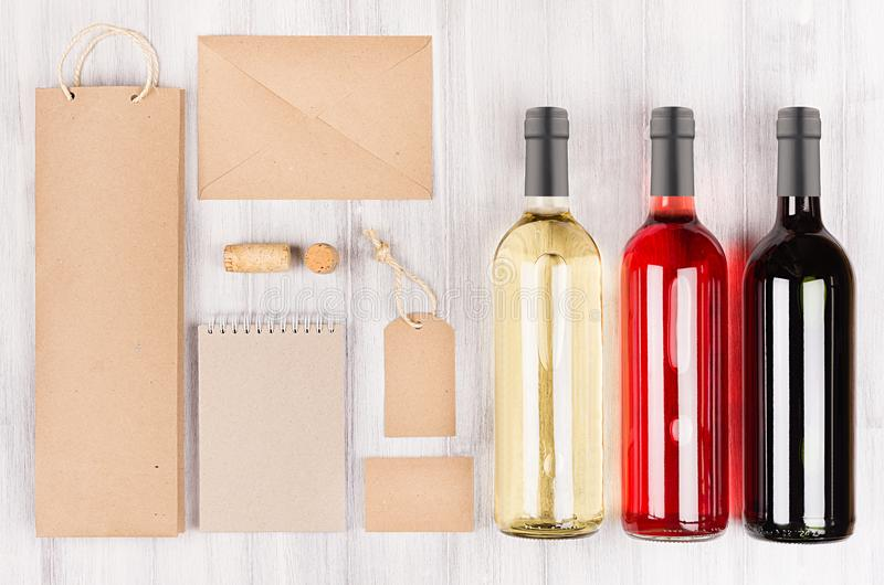 Corporate identity template for wine industry, blank brown kraft packaging, stationery, merchandise set with bottles different wi stock photos