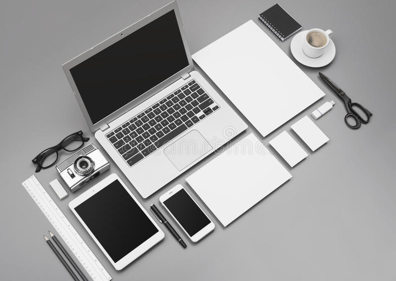 Corporate identity and webdesign mockup. Corporate identity stationary design mockup with smartphone, laptop and tablet pc for responsive webdesign royalty free illustration