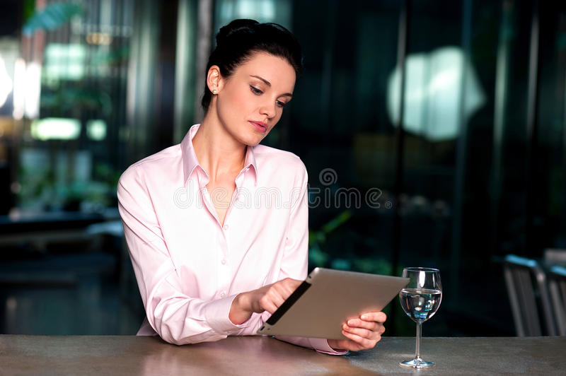 Download Corporate Lady Operating Her Tablet Device Stock Photo - Image: 37591542