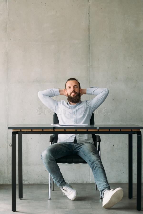 Corporate life confident hipster guy office desk royalty free stock images
