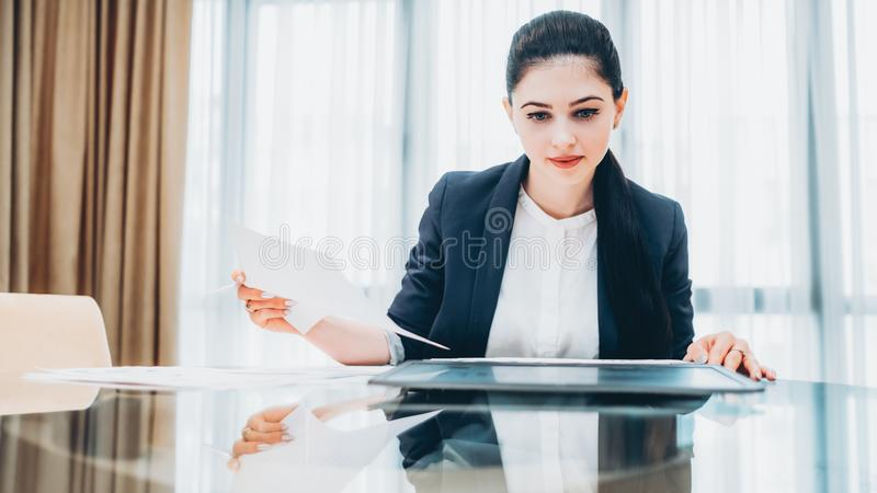 Powerful woman successful business lady office. Corporate life. Powerful woman. Successful business lady working with documents at office stock images