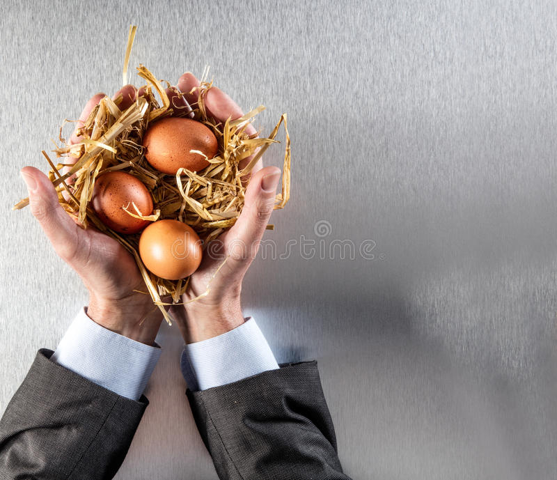 Corporate man hands showing organic eggs for environmental social responsibility stock photos