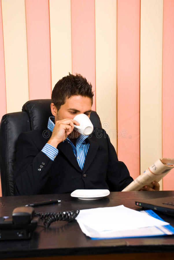 Download Corporate Man Reading News And Drinking Coffee Stock Image - Image: 14802077