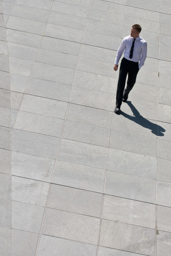 Download Corporate Man Walking On Pavement Stock Image - Image: 10294827