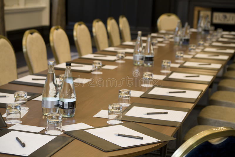 Corporate meeting room. With chairs and tables royalty free stock photography