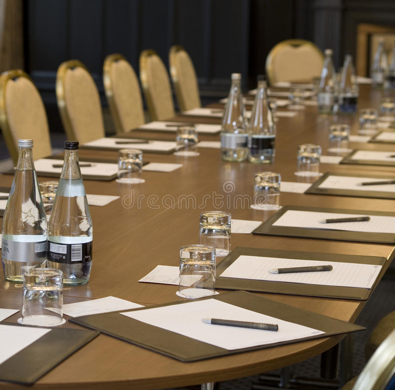 Corporate meeting room. With chairs and tables stock photography
