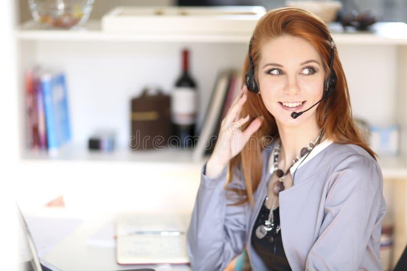 Corporate operator. Female corporate operator at work stock image