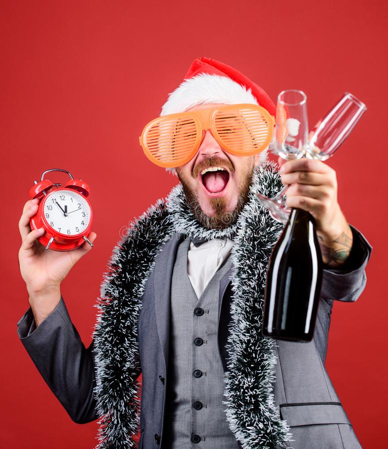 Corporate party. Cheers concept. Join office party. Winter party ideas. Almost midnight. Time to celebrate new year. Christmas party. Man bearded hipster santa stock photo