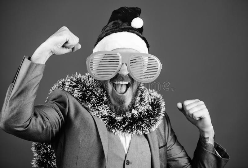 Corporate party ideas employees will love. Corporate christmas party. Man bearded hipster wear santa hat and funny stock image