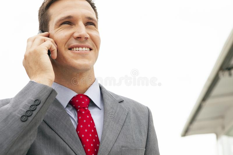 Corporate people - businessman on the phone outside stock images
