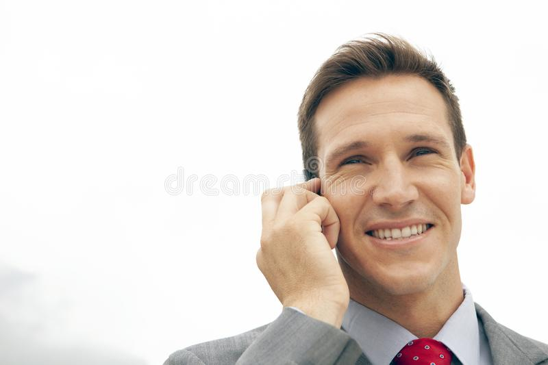 Corporate people - businessman on the phone outside stock photos