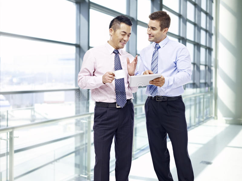 Corporate people discussing business at airport stock photos