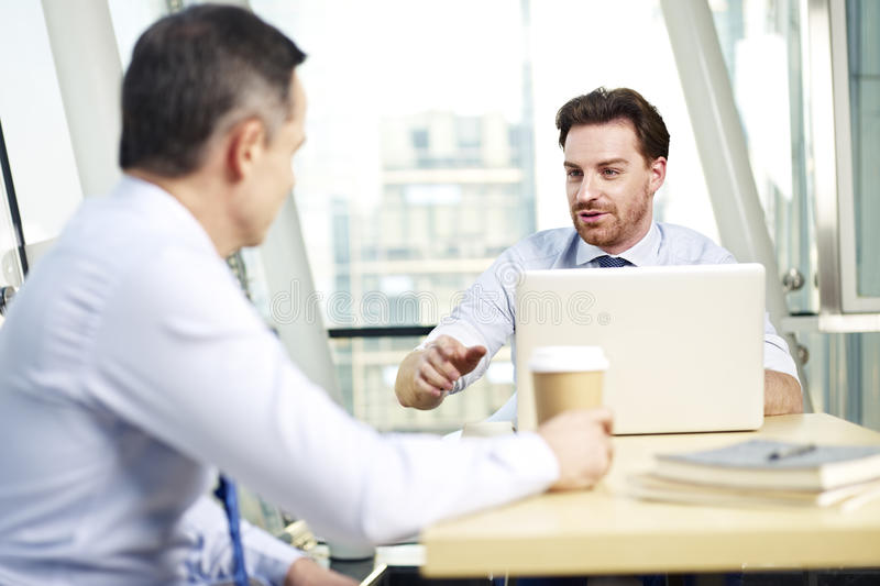 Corporate people discussing business in office royalty free stock photos