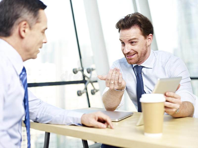 Corporate people discussing business in office royalty free stock image