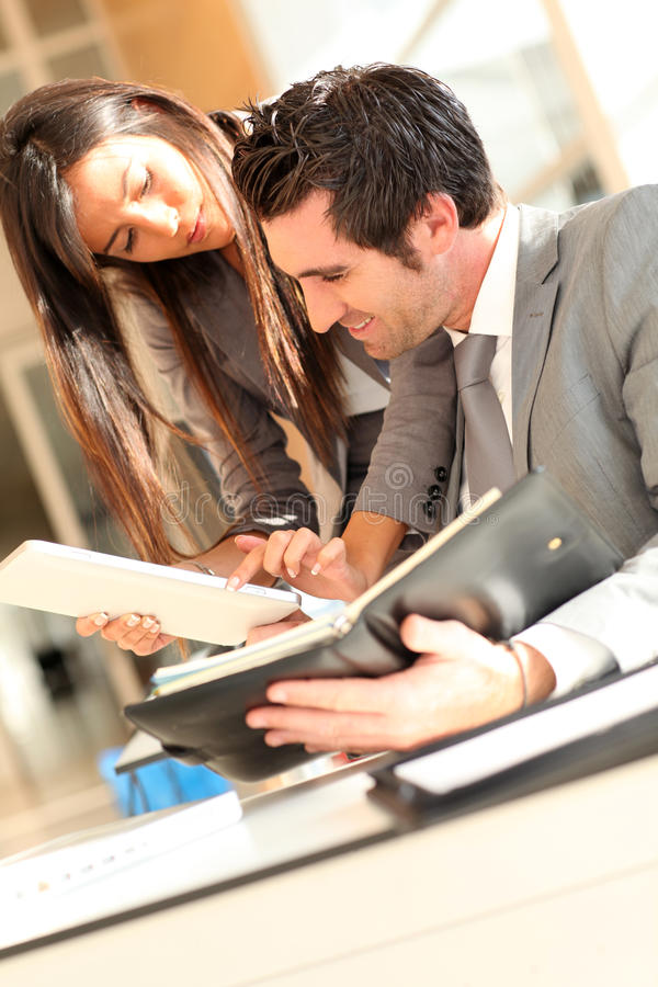 Corporate people working with tablet stock photo