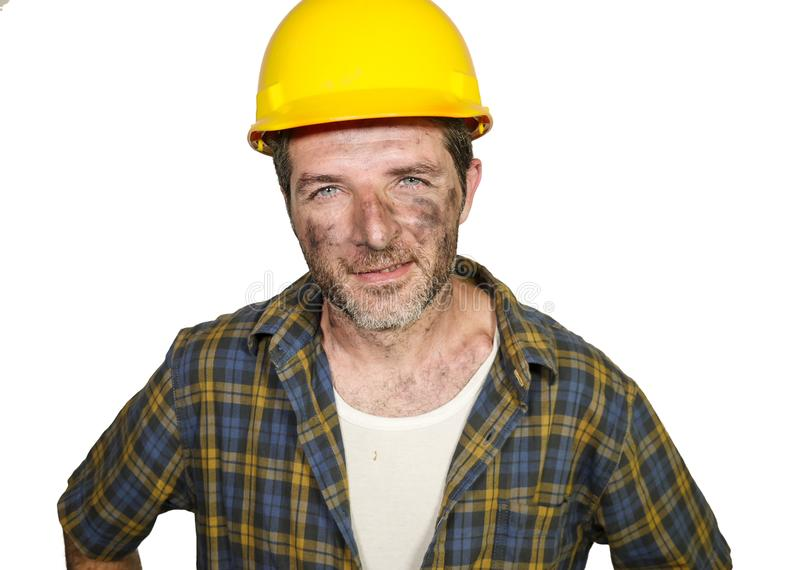 Corporate portrait of construction worker - attractive and happy builder man in safety helmet smiling confident as successful stock photo