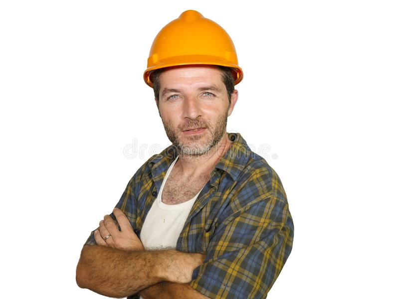 Corporate portrait of construction worker - Handsome and confident builder man in safety helmet smiling happy posing relaxed as royalty free stock images