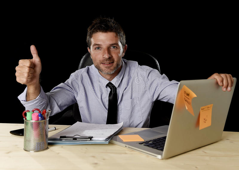 Corporate portrait happy successful businessman smiling at office desk working with laptop computer royalty free stock photo