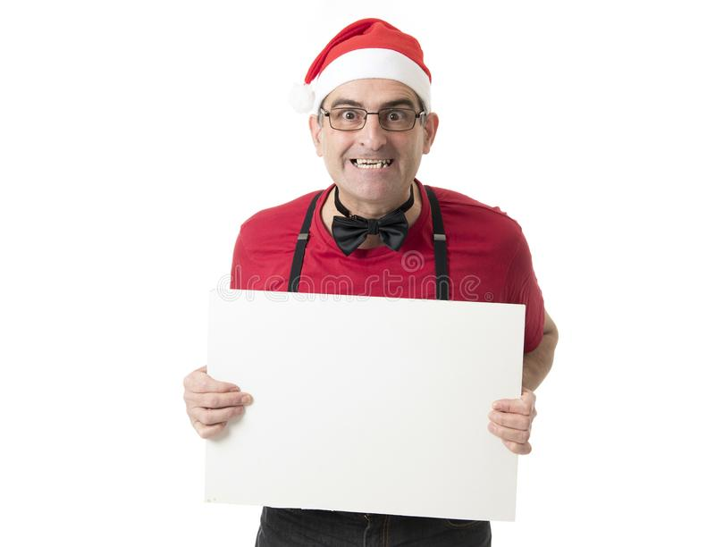 Funny 40s to 50s crazy sales man in Santa Christmas hat with bo royalty free stock image