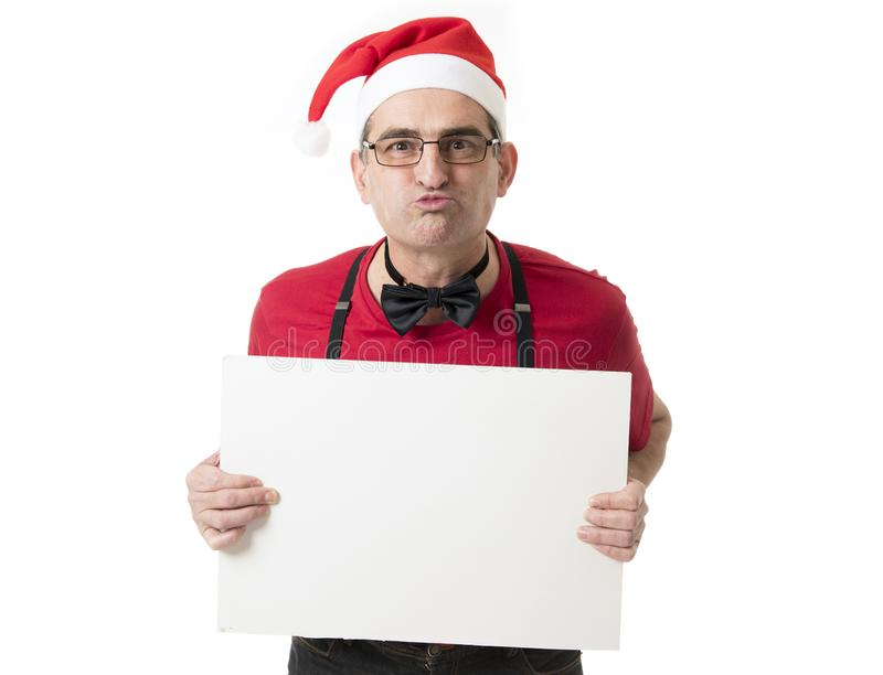 Funny 40s to 50s crazy sales man in Santa Christmas hat with bo royalty free stock photography