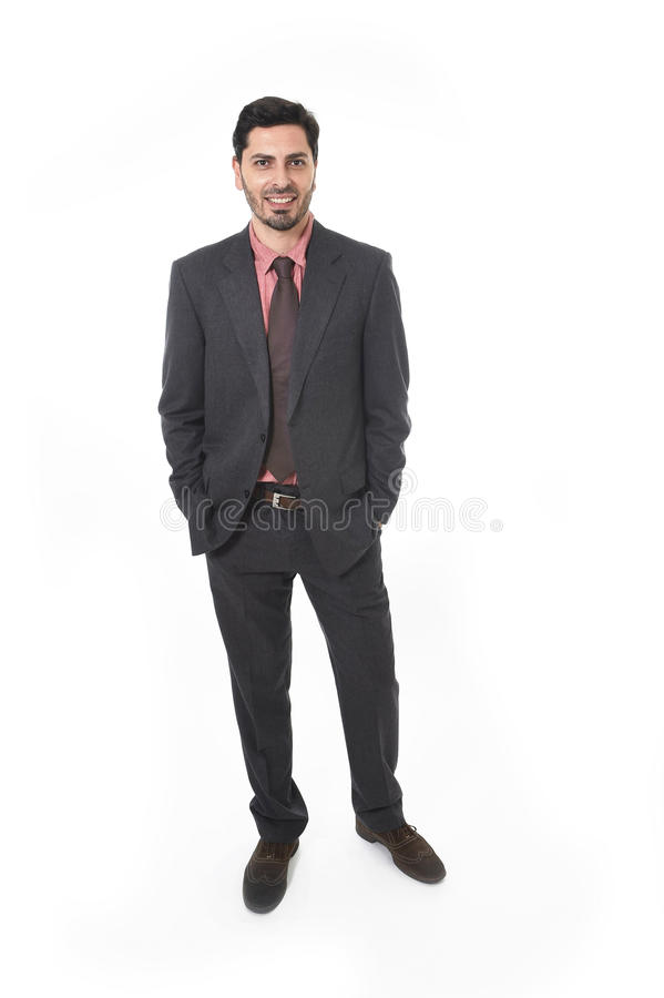 Corporate portrait of young attractive businessman of Latin Hispanic ethnicity smiling in suit and tie royalty free stock images