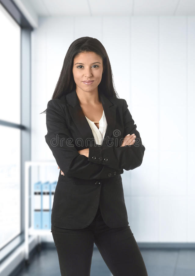 Corporate portrait of young attractive latin business woman wear stock photos