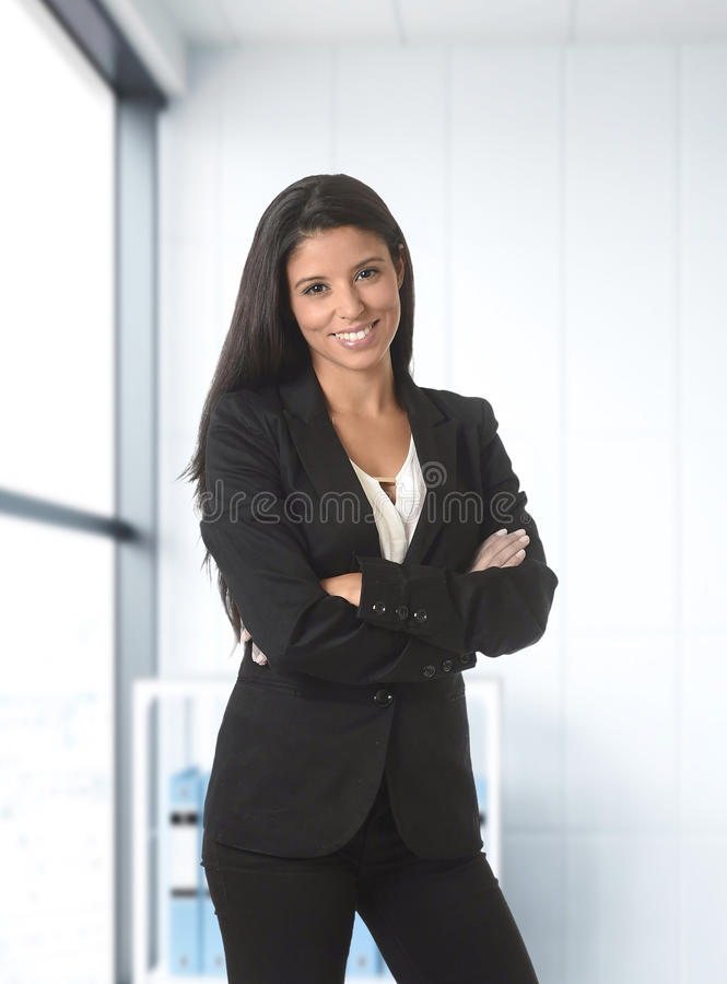 Corporate portrait of young attractive latin business woman wear stock photo
