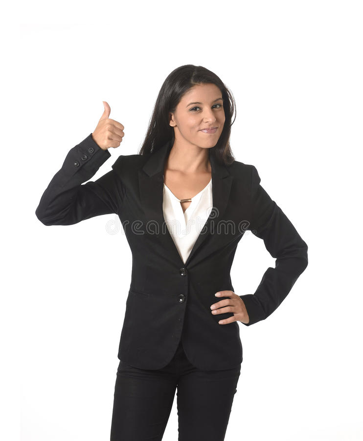 Corporate portrait of young attractive latin businesswoman in office suit smiling happy. Corporate portrait of young attractive latin businesswoman wearing royalty free stock photo