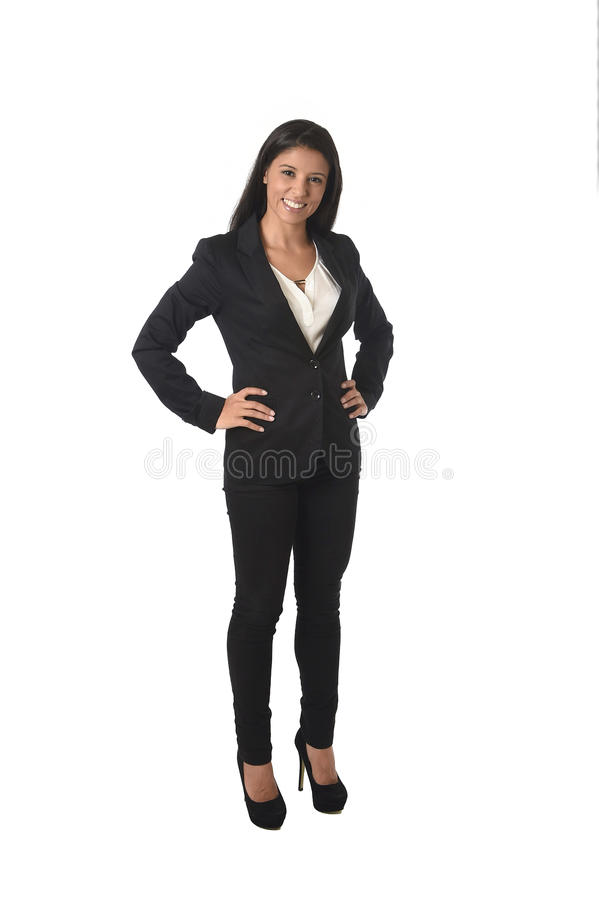 Corporate portrait of young attractive latin businesswoman in office suit smiling happy. Corporate portrait of young attractive latin businesswoman wearing royalty free stock image