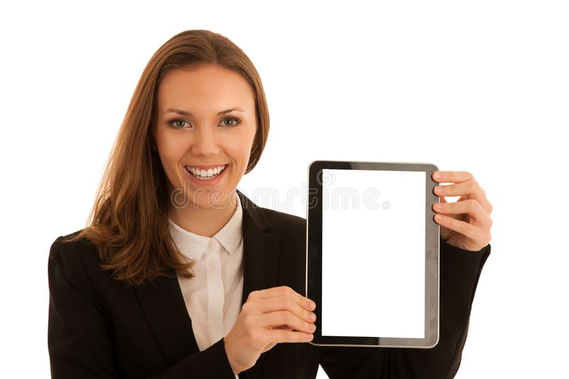 Corporate portrait of young beautiful caucasian business woman s. Urfinh internet on tablet isolated over white background royalty free stock photography